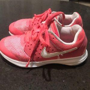 Girls pink Nike shoes
